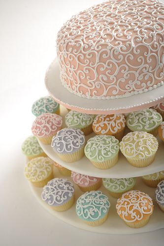 This is a wedding cake and cupcakes done right.