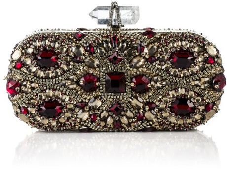 Fw Lily Embroidered Clutch  MARCHESA  Fw Lily Embroidered Clutch  This opulently embellished oval box clutch features all-over ruby and champagne colored Swarovski crystals. Prism-shaped quartz push lock closure with crystal-studded crisscross accent. Metal frame with Swarovski crystal-embellished body. Tulle-lined interior features single slip pocket ...     NOTIFY ME WHEN BACK IN STOCK  or See Related items    €2420 at Moda Operandi - Sold Out