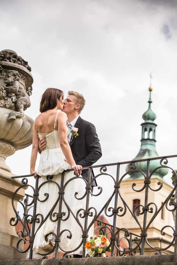 This a lovely view with bride and groom and church in #prague #wedding