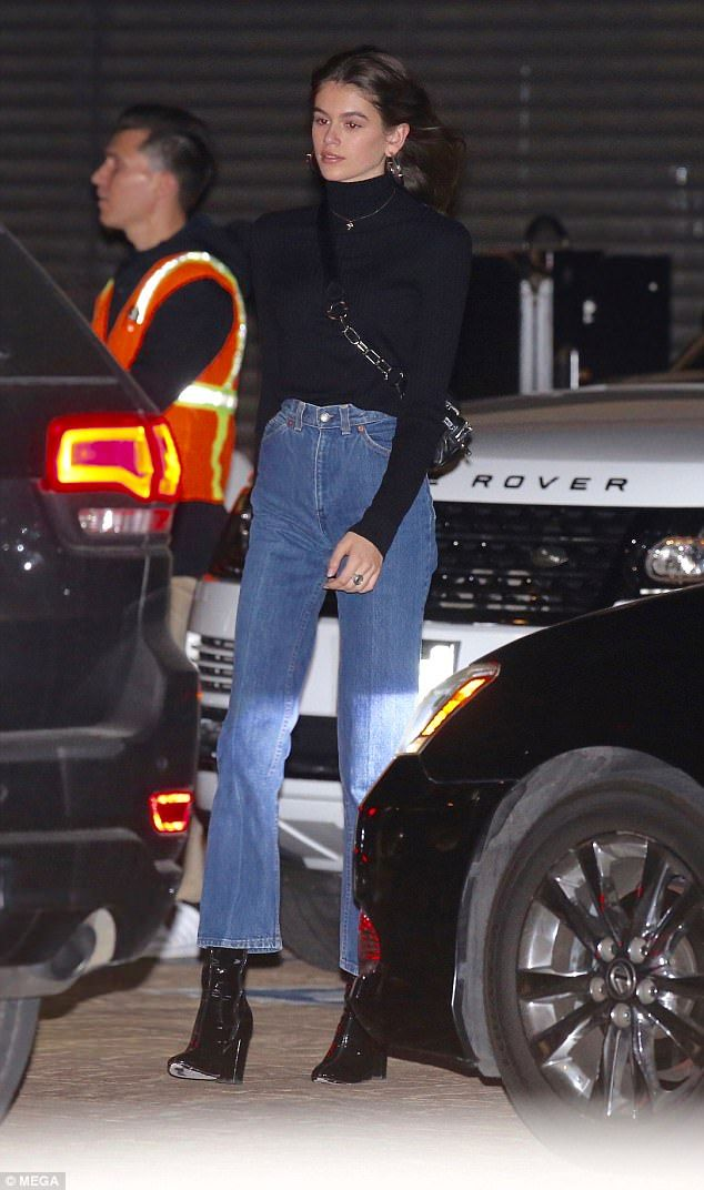 Model prodigy: Casually clad Kaia Gerber, 16, rocked a retro black roll neck and high-waisted jeans as she dined out with age-defying mum Cindy Crawford, 51, in Los Angeles on Sunday