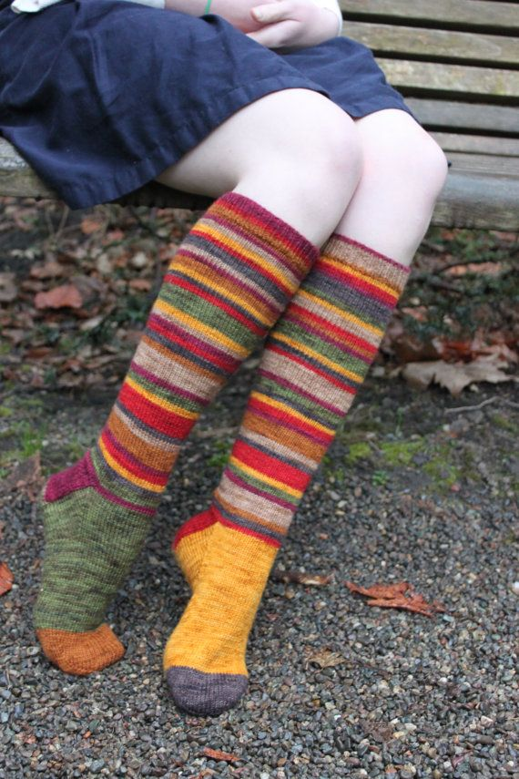 These stripy socks are inspired by the BBC's television character the Fourth Doctor from the sci-fi hit Doctor Who. Knit using a yarn set