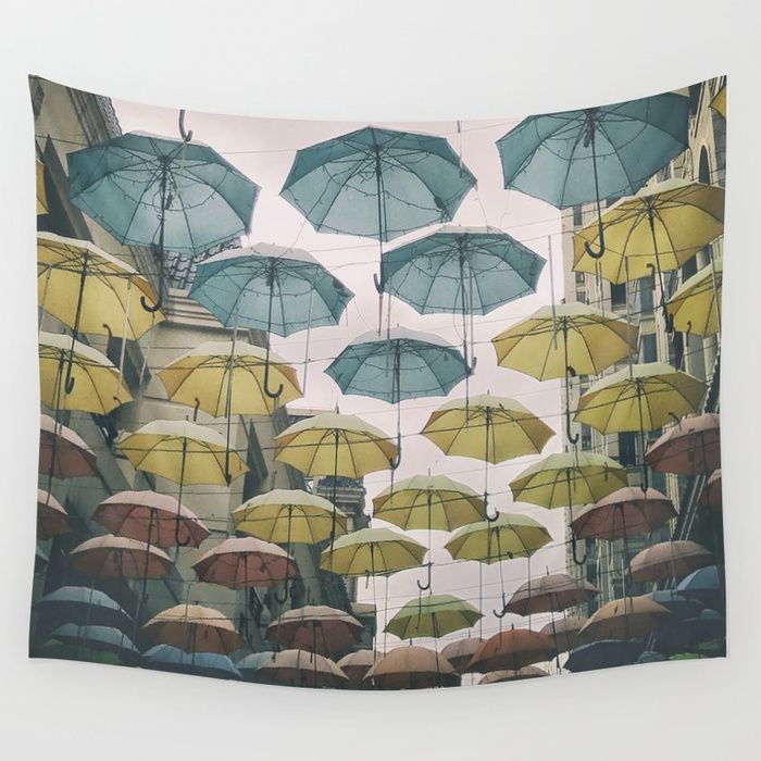 Buy Umbrellas in the sky Wall Tapestry by ibphotos. Worldwide shipping available at Society6.com. Just one of millions of high quality products available.