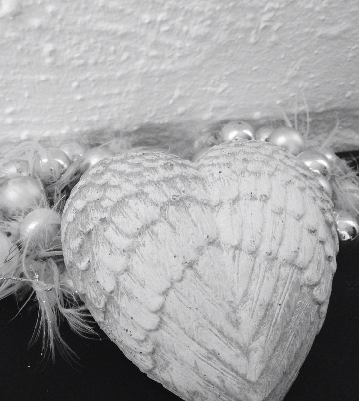Concrete feather heart in shabby style, beutiful decoration