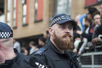 """A Bearded """"Hipster Cop"""" From The Protests In London Has Become A Huge Meme"""