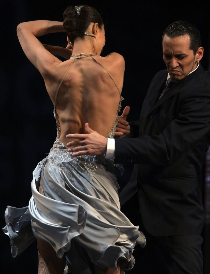 Argentine couple of Naoko Tsutsumizaki (L) and Cristian Andres Lopez dance during the semifinal round of the Stage Tango competition at the Tango Dance World Championship in Buenos Aires on August 25, 2012. (ALEJANDRO PAGNI - AFP/Getty Images)