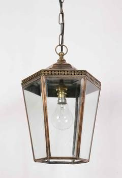 For front door. Chelsea Pendant, small LA73 The Chelsea Pendant, Small is a fine example of an English Edwardian styled Hanging Lantern. Ideal for porch, hall or conservatory lighting. The Chelsea Pendant is also available in Large. Suitable for use in covered exterior areas.  Shown here in antique brass.
