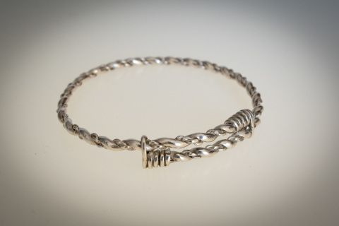 This+elegant+bangle+features+triple+twists+of+sterling+silver+and+is+adjustable+from+6cm+-+7cm+internal+diameter.