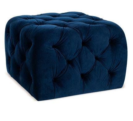 upholstered in blue velvet, a tufted ottoman