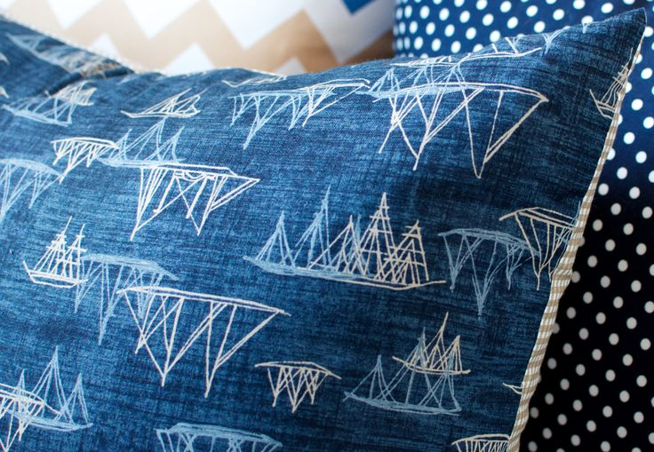 Navy Sailing Boat Cushion  Size 45cm x 45cm  Add a classic nautical theme to your room with this unique sailing boat cushion. The fabric is high quality 100% Cotton, with the Sailing Boat pattern featured on one side in Navy, Sky Blue and Beige, and a Beige and White gingham pattern on the reverse side.  For custom order enquiries, please contact lauren@laurenunlimited.com.au