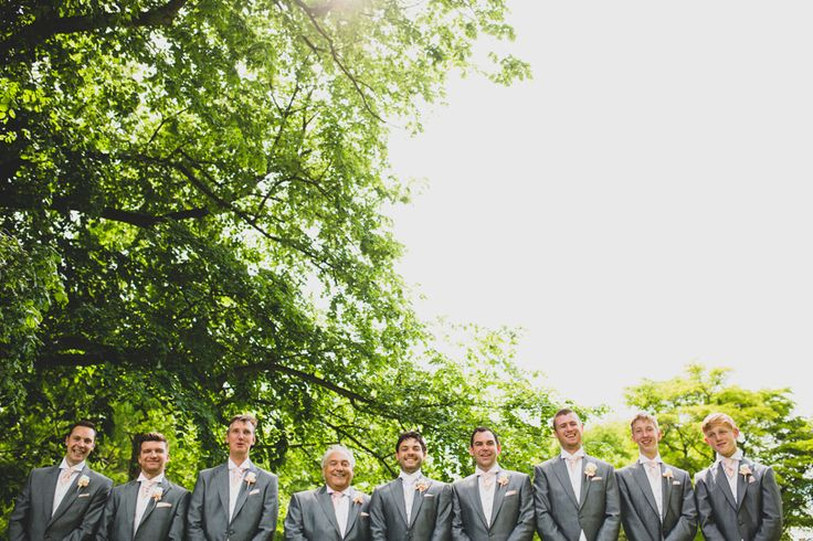 Groom and his groomsmen at a Tatton Park wedding wearing slate grey tails and blush-pink cravats.  photo by tobiah tayo photography -  available for commissions worldwide  www.tobiahtayo.com