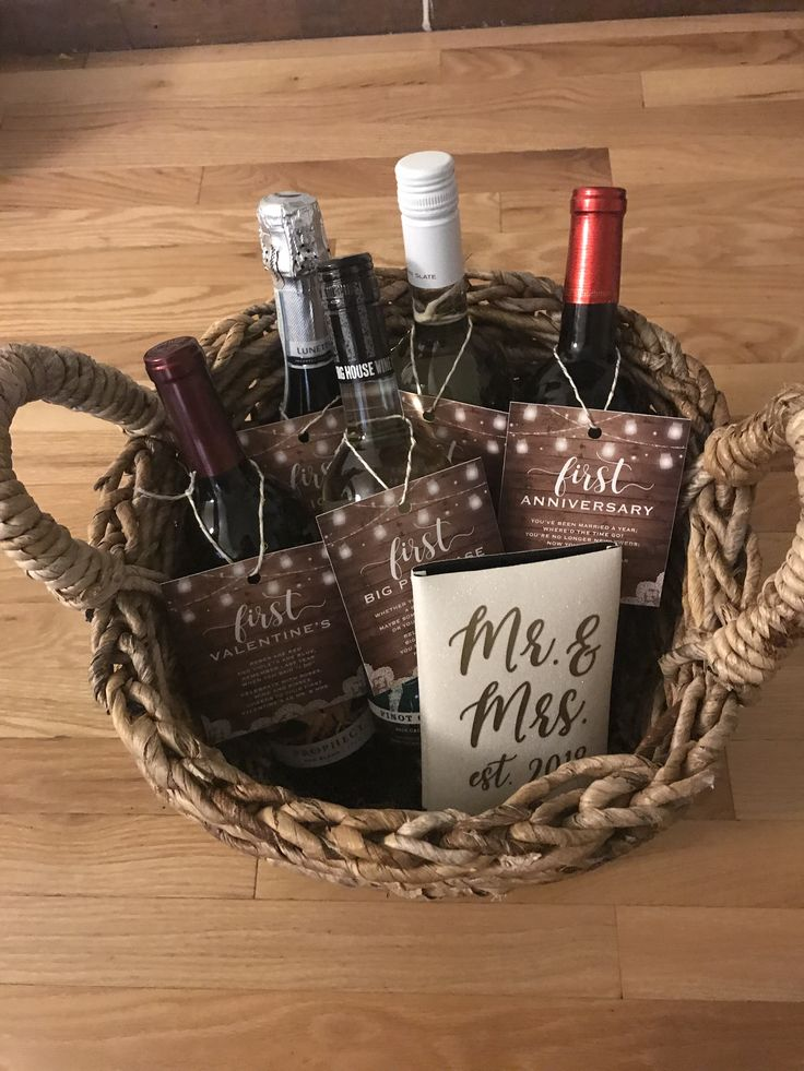Bridal shower gift basket full of wine bottles of firsts