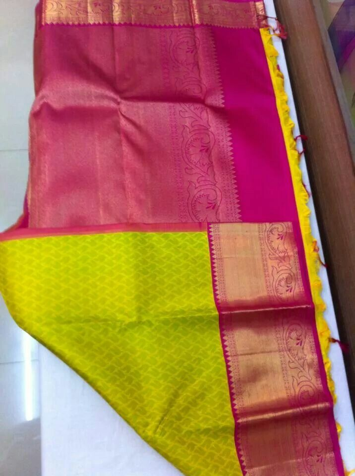 Beautiful kanjeevaram silk saree in parrot green colour with heavy pink border