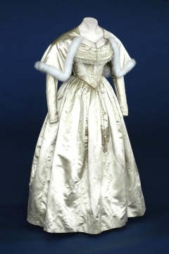 Wedding Dress, England, 1840.  Wedding dress in old gold satin with shoulder cape edged with white swansdown.
