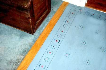 stenciled wood floor...would consider a partially painted  wood floor with a stencil, but with a less folksy stencil than this one