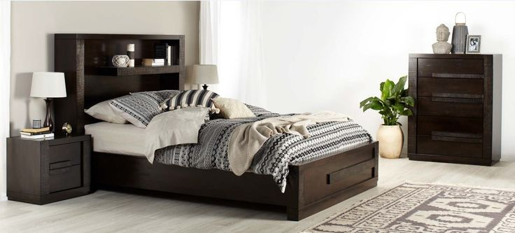 Java modern dark wooden bedroom furniture suite with built in shelving and  black, white and beige patterned linen and decor