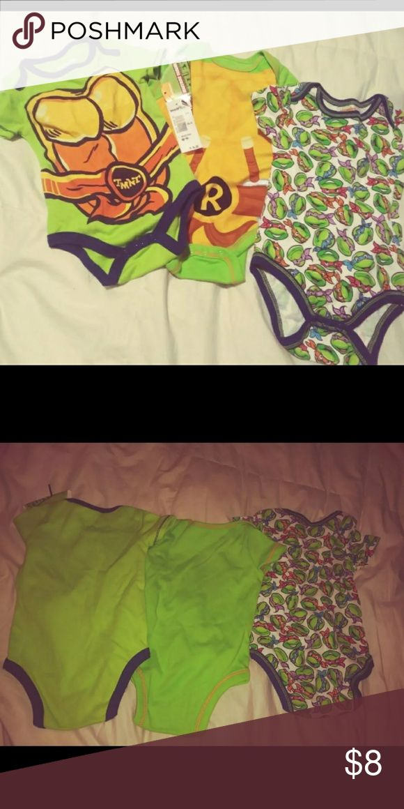 New with tags Ninja Turtles onesies 0 to 3 months unused never worn 3 pack of Teenage Mutant Ninja Turtle onesies one still has the tag on it only one had attack on it came in a 3 pack One Pieces Bodysuits