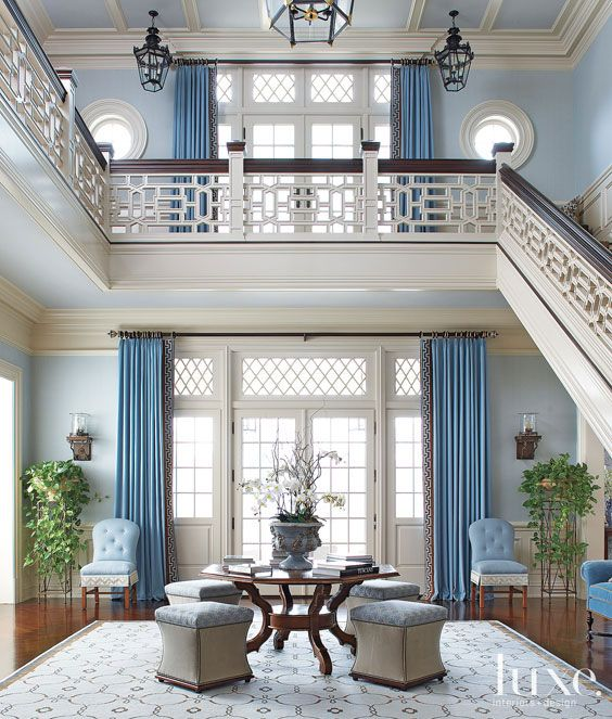 The Chippendale-style fretwork on the stair railing gives this foyer a garden-like appeal.