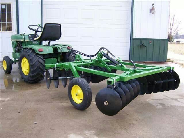 JOHN DEERE 140 with a custom built disk