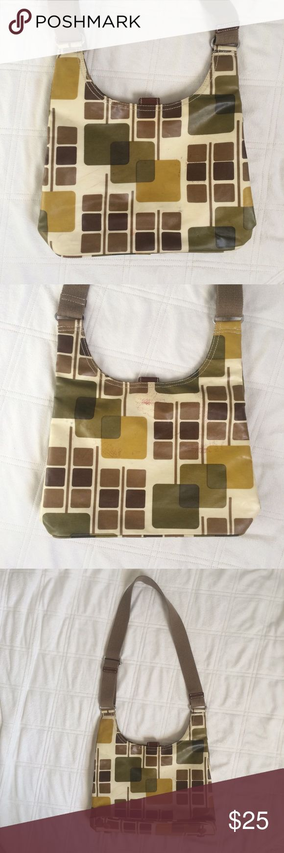 """ORLA KIELY CROSSBODY GEOMETRIC LAMINATED BAG Such a fun retro style print! ORLA KIELY laminated cotton crossbody purse. Exterior shoes wear, please see photos. Interior in excellent condition. Magnetic closure, feet on the bottom, canvas adjustable strap, elastic key holder, one interior zippered pocket wit two additional interior pockets. 13"""" wide by 13"""" tall. There are exterior stains and the price reflects this. Orla Kiely Bags Crossbody Bags"""