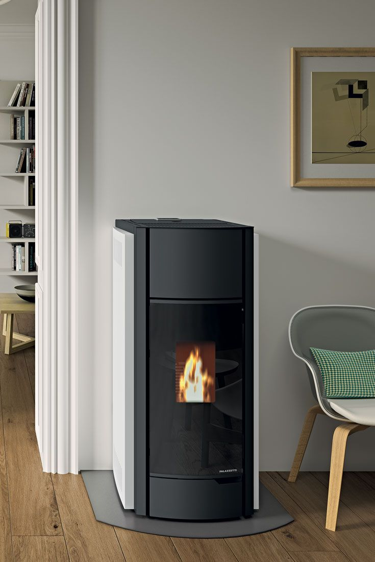 ECOFIRE® JULIE | A sealed, air-heating pellet stove with painted steel cladding and a glass door. Available in white, red, black or soapstone. • Una stufa di design a pellet ermetica ad aria con rivestimento in acciaio verniciato e porta in vetro. Disponibile in bianco, rosso, nero e pietra ollare. | #arredamento #arredo #interiors #home #decor #living #room #palazzetti #autunno #2016
