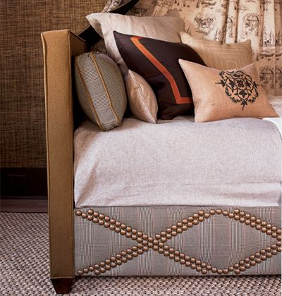 Daybed using oversized brass nail heads. New Orleans Home ideas.
