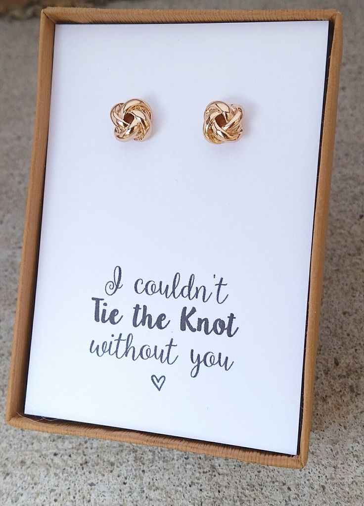 """18k rose gold/white gold plated knot stud earrings. Comes with the message, """"I…"""