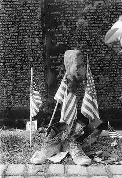 """Since the Vietnam Veterans Memorial was dedicated in 1982, countless offerings have been left at """"The Wall"""" in memory of the more than fifty-eight thousand soldiers whose names are engraved on its surface. The National Park Service, which collects and preserves these mementos, loaned many of them to the Smithsonian in 1992 for an exhibition marking the memorial's tenth anniversary."""
