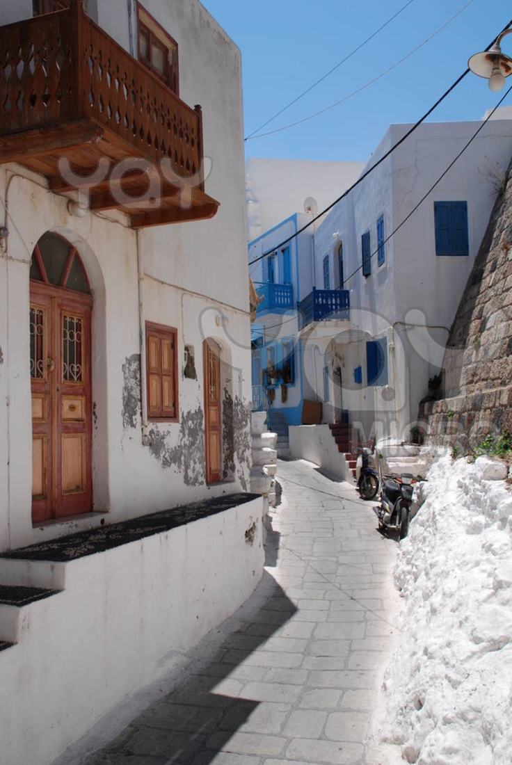 Wandering through towns on any Greek Island is one of life's indescribable pleasures. This is a narrow street in Mandraki on the Greek island of Nisyros