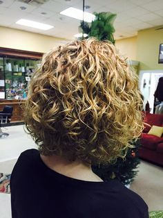 very nice medium length permed style with loose curl