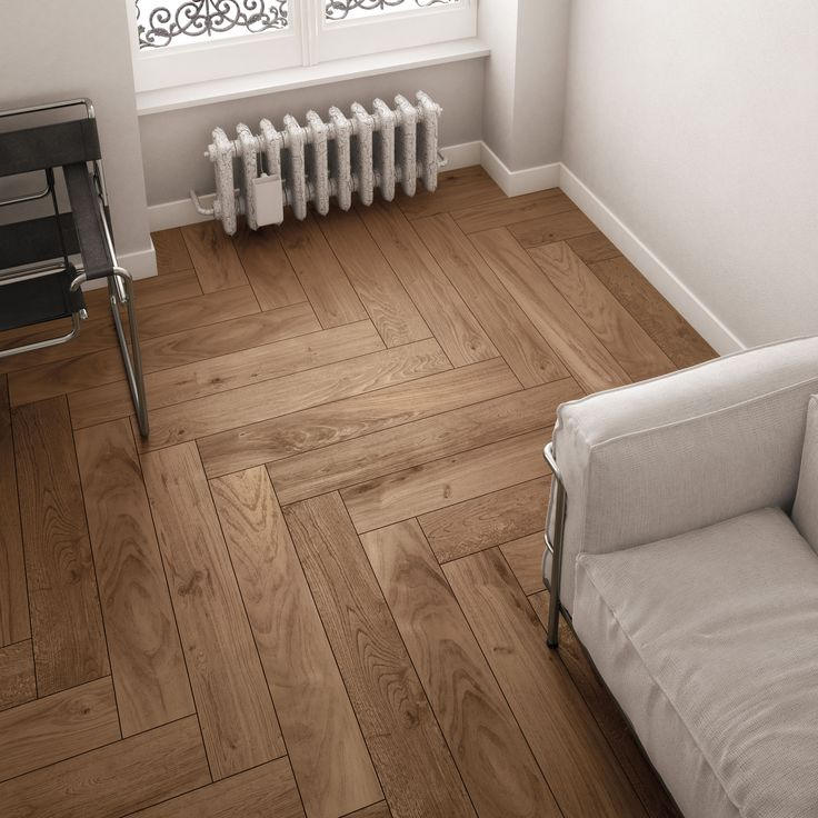 The herringbone pattern in wood look ceramic tile takes advantage of its uniform size.