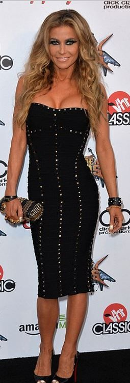Carmen Electra: Dress – Herve Leger  Shoes – Christian Louboutin  Purse – Alexander McQueen