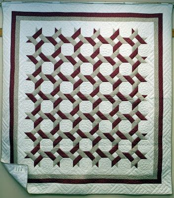 Around the Twist, Amish quilt, 2009. The magnificent snowball quilt called Around the Twist, above, was made by the Amish Church of Hutchinson, Kansas, and was featured at the 2009 Mennonite relief auction. - Quilt Inspiration: Snowballs for all seasons