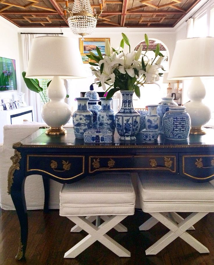 Living Room Decorating Ideas. Sofa console table filled with blue and white porcelain ginger jars. Palm Beach Style.