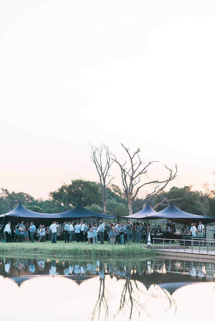 Canpes at the wedding served on the Island in the middel of a dam connected to the Limpopo River ONLY at Palala Boutique Game Lodge. Photograph by Louise Vorster Photography