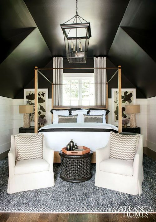 smart design of an attic bedroom. wainscoting halfway up the wall, then the remainder is painted black and downplays all the crazy angles. More