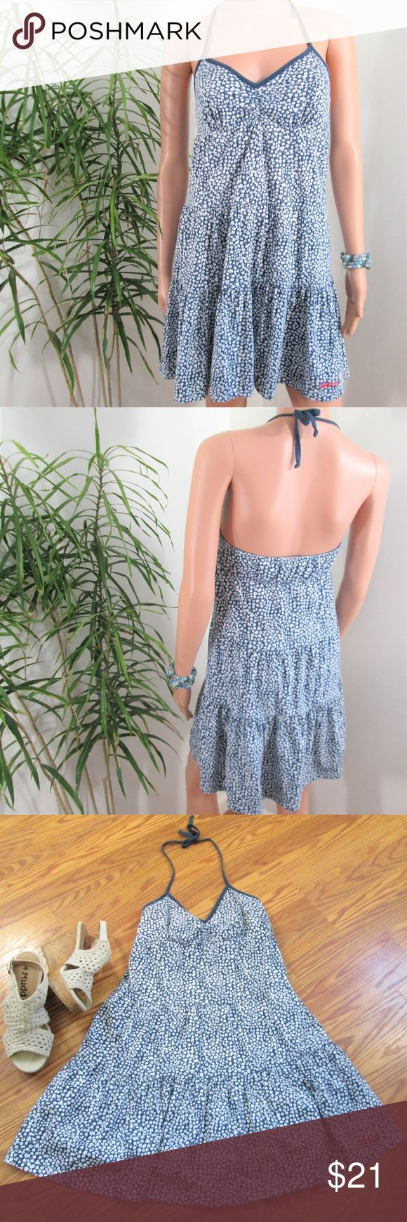 """Billabong*  Open Back Baby Doll Mini Dress Sweet no fuss floral popover. Ties at neck, tiered skirt. Empire waist, shelf bra. Blue with white tiny daisy print.  Measured flat - not stretched. 14"""" pit to pit. 28"""" long without straps. Mid thigh on 5"""" 9' model, 33'' x 24'' x 33.5''.  55% cotton 45% modal Billabong Dresses Mini"""