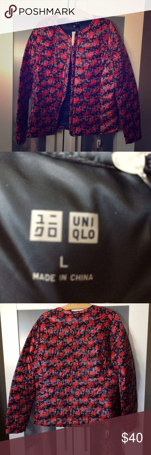 Ultra light down jacket NWT, never worn. Comes with stuff jacket. Navy with red pattern. Uniqlo Jackets & Coats