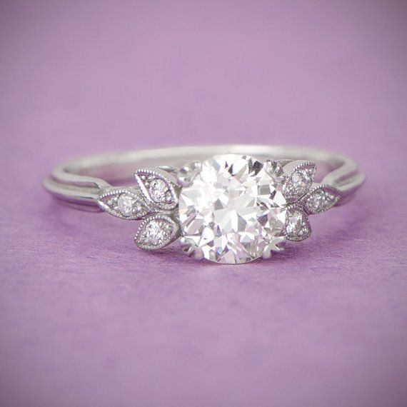 A timeless Art Deco Style Engagement Ring, accented by diamonds along the shoulder. The old European cut diamond is prong set and is