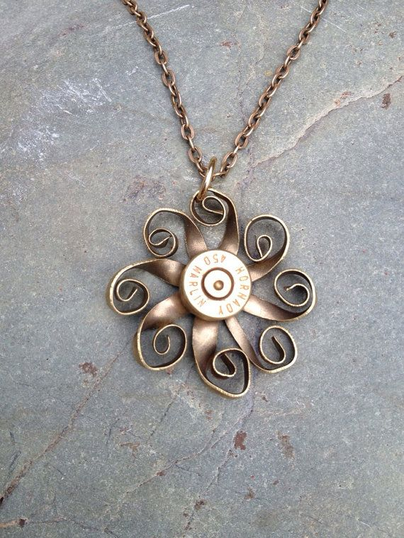 Floral pendant necklace made from a recycled brass bullet casing. Edges are sanded and has been tumbled to remove sharp edges. Also went through acid