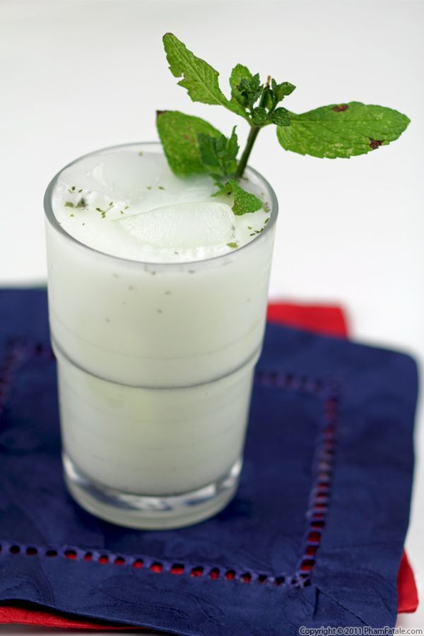 Doogh (Persian Yogurt Drink - 8 servings): 1 quart yogurt / 1-½ tablespoons honey (optional) / 1-½ tablespoons dried mint (or 12 fresh mint leaves), to taste / ¼ teaspoon cumin seeds (optional) / freshly ground 4 cups crushed ice / 2 quarts seltzer water (or still water) / whole fresh mint leaves, for garnish.