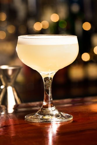 """5 Speakeasy Cocktails...And Their Shady Pasts #refinery29  http://www.refinery29.com/46674#slide5  White Lady  Introduced in the late '20s, The White Lady was born from the drink the """"Delilah,"""" which included crème de menthe. The Savoy's Harry Craddock replaced it with orange liqueur, and it became an instant classic.  1.5 oz Tanqueray London Dry Gin .75 oz orange liqueur .75 oz lemon juice Pour all of the ingredients into a shaker, fill with ice, shake and strain into a chilled coupe glass…"""