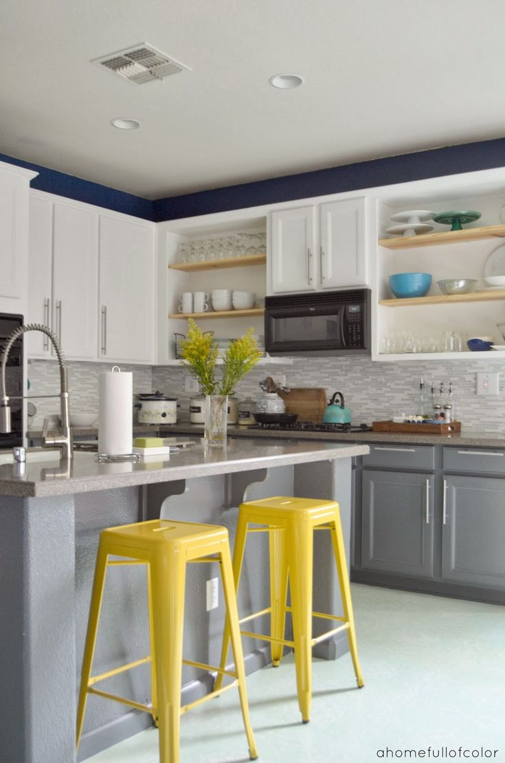 Love the white top and grey bottom cabinets i like the for Blue kitchen cabinets with yellow walls