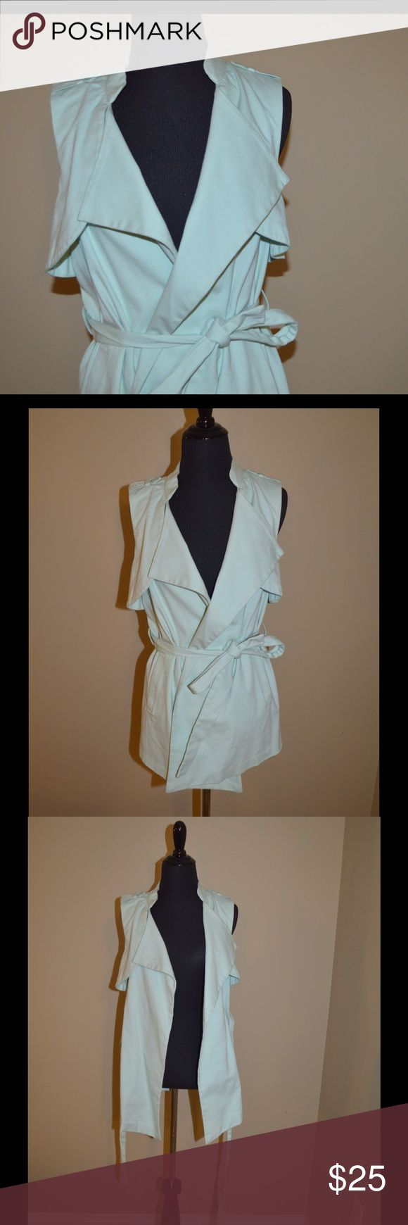 BCBG Baby blue Vest This BCBGeneration vest is beautiful. Like new condition. Ties around the stomach. Very smooth texture and comfortable. Just dry cleaned! BCBGeneration Jackets & Coats Vests