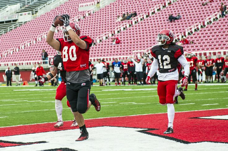 (Chris Detrick  |  The Salt Lake Tribune)  Utah Utes tight end Westlee Tonga (80) scores a touchdown past Utah Utes linebacker Jared Norris (41) and Utah Utes defensive back Justin Thomas (12) during a scrimmage at Rice-Eccles Stadium Saturday April 5, 2014.
