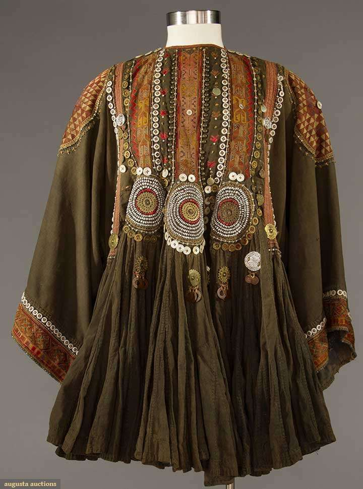"""WOMAN'S JUMLO TOP, PAKISTAN   Black cotton w/ tan & burgundy embroidery, silver beads, coins & m-o-p buttons, L 34"""", (faded, few missing embellishments) very good."""