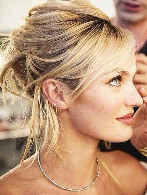 Candice Swanepoel- love the hair style.