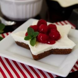 These adorably festive gingerbread cakes are topped with a no-bake cream cheese filling and Christmas red cherries.