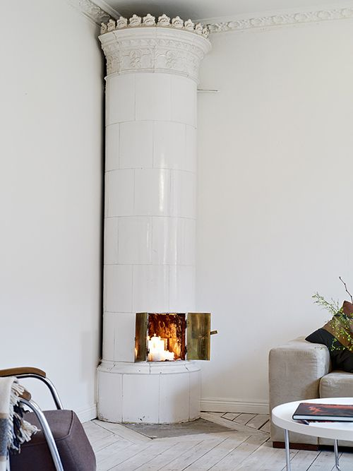 forget those hideous woodburning stoves....I want one like this...classy ;)