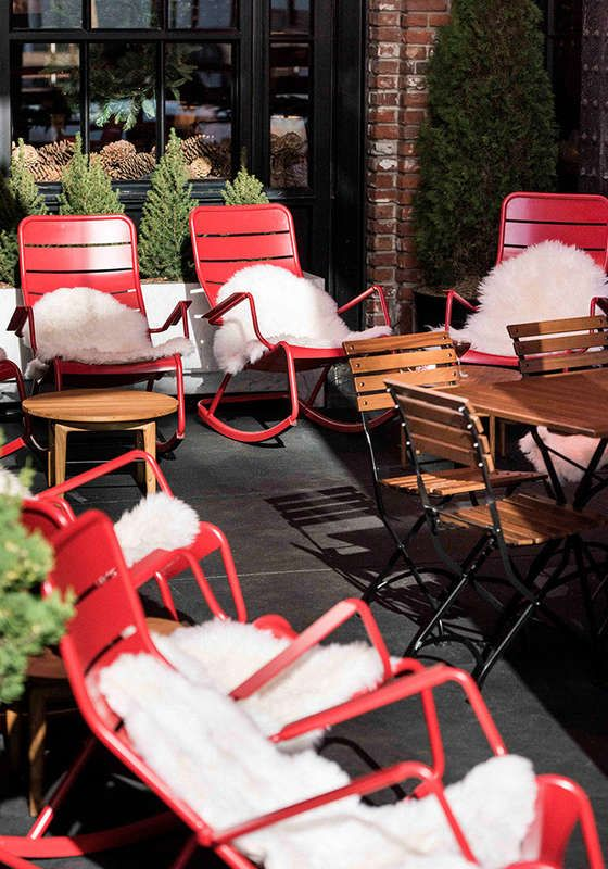 The Standard Hotel High Line Ice Rink - Fermob Luxembourg rocking chairs.