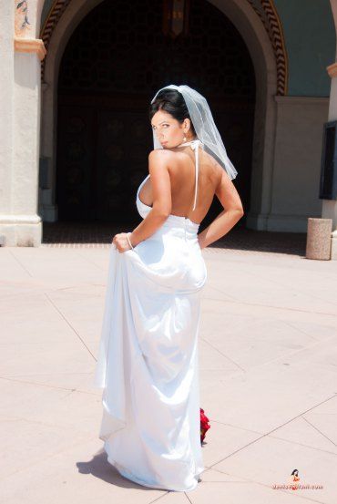 Wonderful white gown with Denise Milani.